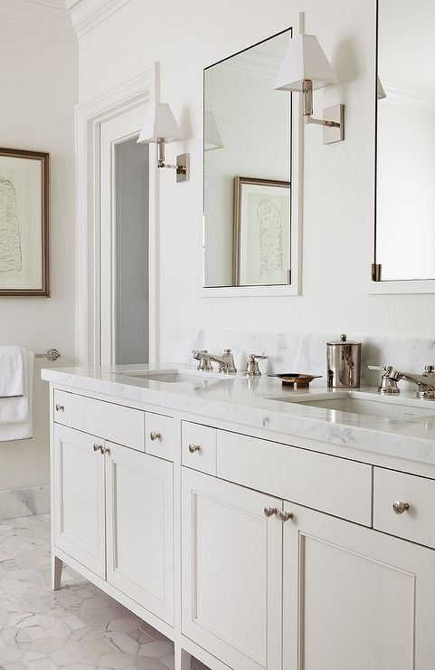 Chic Master Bath Features A Cream Double Vanity Topped With White Marble Ed His And Her Sinks Under Framed Inset Medicine Cabinets