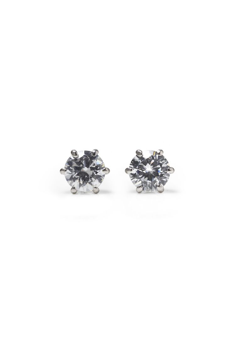 Make it a set. Classic Ehinger Schwarz diamond prong setting earrings matching your engagement or wedding ring. They are fashioned in 18k white gold.