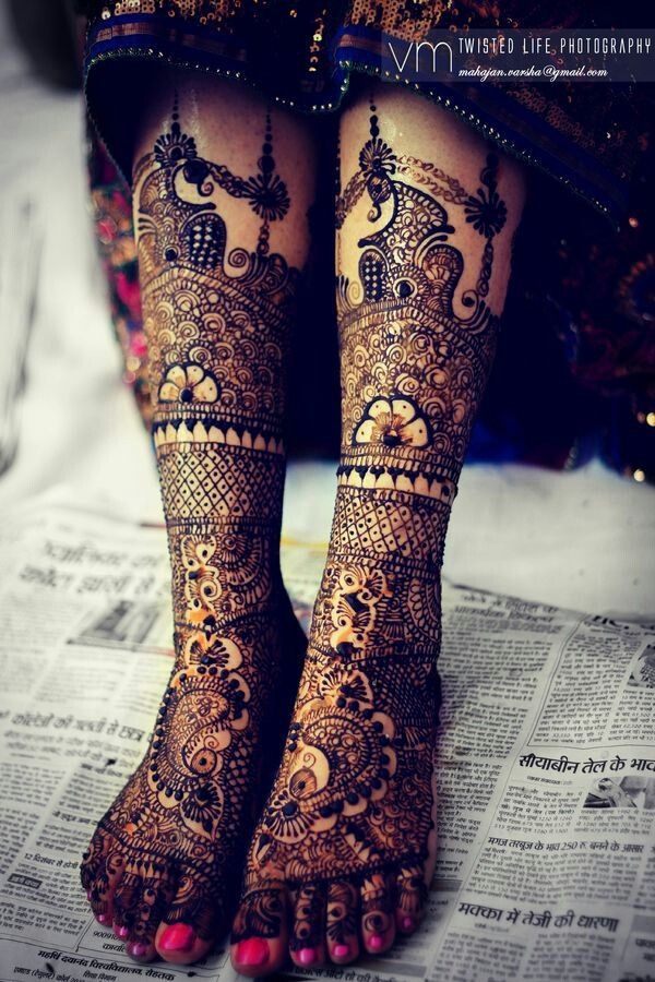 Bridal mehndi or henna designs on leg