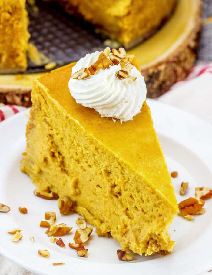 Thick, rich, and delicious! This Pumpkin Cheesecake is the perfect addition to your fall celebrations! Pin this to your Pumpkin Recipes or Fall Recipes board. | Dessert recipes from #iambaker #iambakerdessert
