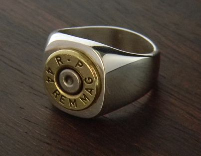 Mens Marksman Sterling Silver Bullet Ring instead of a class ring.  He will wear it longer.