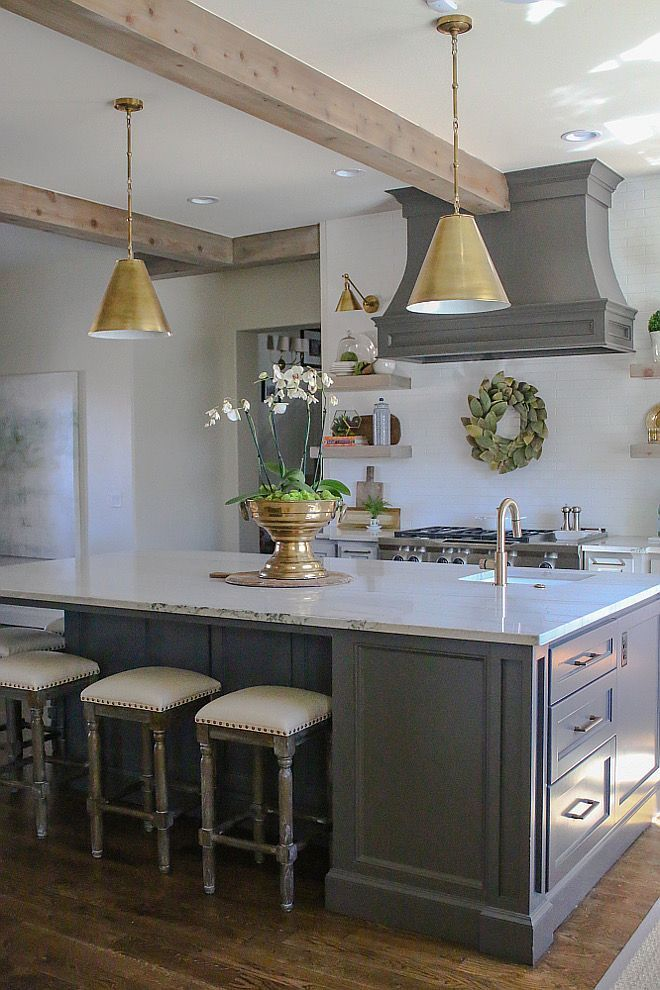 love this kitchen! From the brass pendant lanterns to the gorgeous hood - perfect!