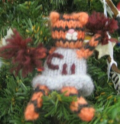 My Campbellsville University Tiger cheerleader  It can be a pin, ornament, or even a finger puppet.