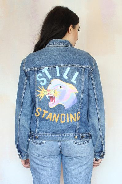 The Still StandingDenim Jacket features a hand painted motif to the back. Each jacket is unique and will vary slightly in colour.    100% Cotton Created in