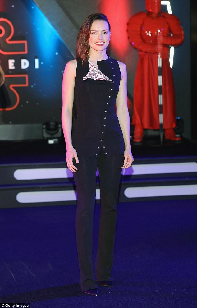 Glamorous: The 25-year-old actress donned an all-black ensemble as she waved to reveler's ...