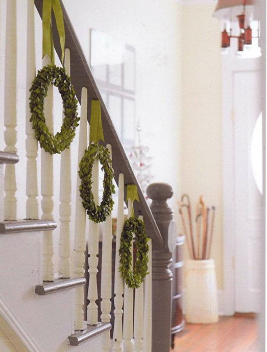 Bannister decor -- Looks much easier than my garland! Perhaps I can find some wreaths after Christmas this year?