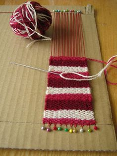 Improvising.  Much better than the tiny (thin) little bracelet loom we have!!