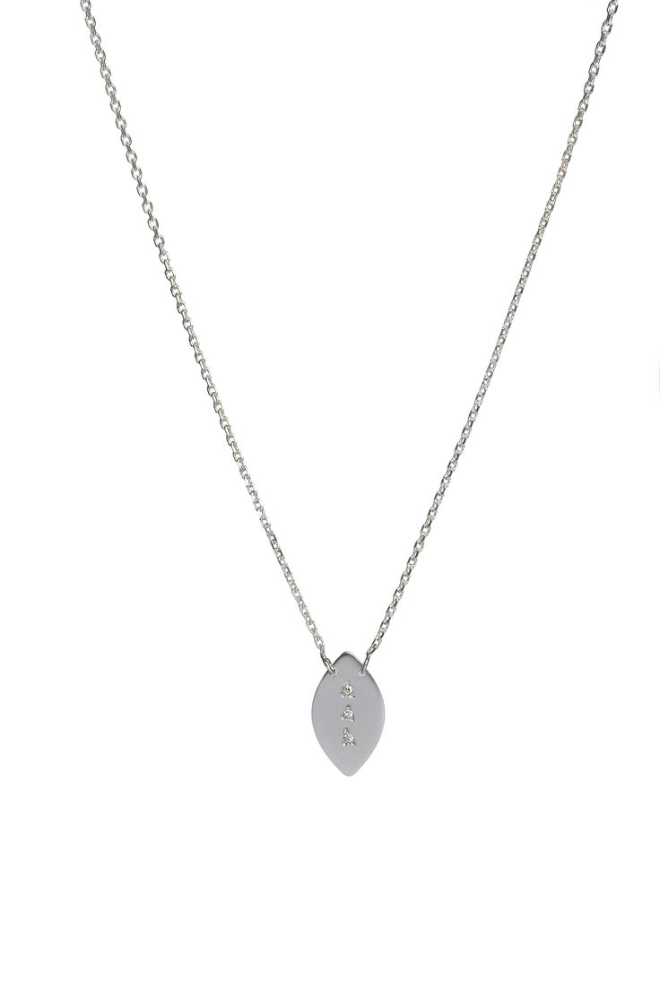 Oval pendant with 3 diamonds, on a fine 14k gold chain. Available in white or yellow gold and multiple chain length options.  Free personalized engraving on the back of the pendants. Shop the collection at www.reena.ro or order directly at reena.orders@gmail.com.