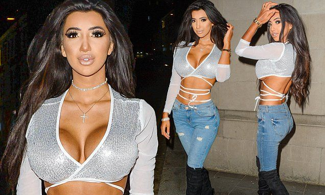 Busty Chloe Khan puts on an eye-popping display in a tie-up crop top