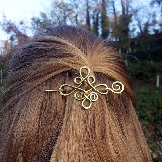 Celtic hair slide / hair barrette was handcrafted from 1.5 mm thick brass wire, hammered and polished for a shiny look. ► MATERIAL ◄ ~ Brass ~ German silver (last pic) (an alloy of copper/zinc/nickel) ► SIZE ◄ This slide is about 6 x 5 cm It will fit well for partial holds of your