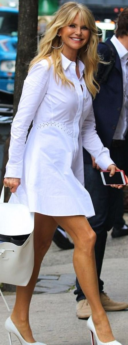 Who made Christie Brinkley's white shirt dress, pumps, and handbag?