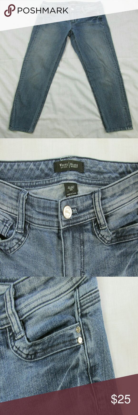 White House Black Market Jeans Size 00 WHBM Blanc Jeans Size 00.  Has rhinestone rivets.  Good condition with no flaws. Waist: 26 in. Inseam: 28 1/2 in. Front Rise: 7 1/2 in. Back Rise: 9 1/2 in. Hips: 33 in. Thighs: 17 in. Leg Opening: 11 in. White House Black Market Jeans Skinny