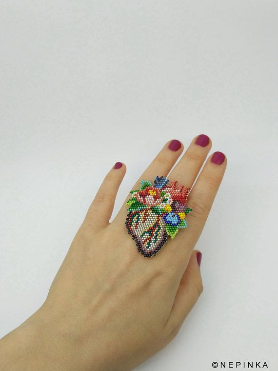 Flower anatomical heart ring is available as single item or with an additional watering can to choose. Designed and hand beaded by nepinka.  The very tiny glass beads are carefully stitched to one another (the heart consists of app. 800! beads) Beads I use are expensive Japanese glass beads,