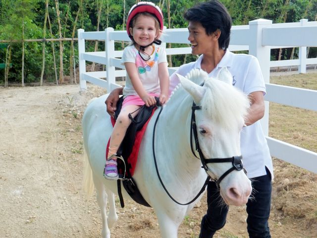 A Tiny Tot pony ride at Bali Equestrian Centre, which finishes off with brushing, grooming, tickling, chatting with and feeding the ponies a snack, was the perfect first introduction to horse-riding for these (now pony mad!) little ones.    www.travelling-bali.com