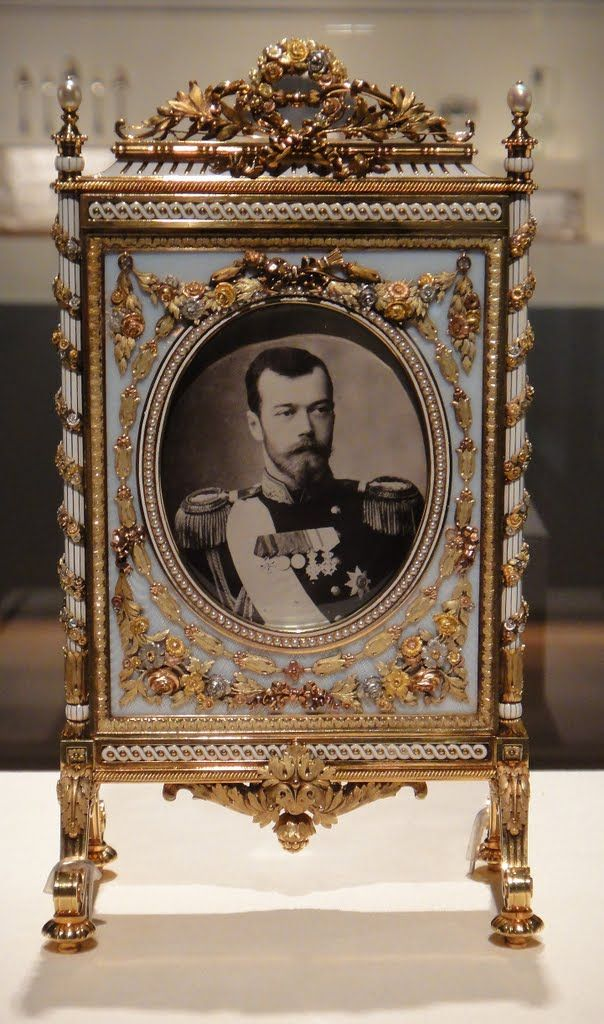 Fabergé Fire Screen Frame, Varicolored gold, platinum, enamel. Circa 1910 Picture frame with photograph of Tsar Nicholas II.