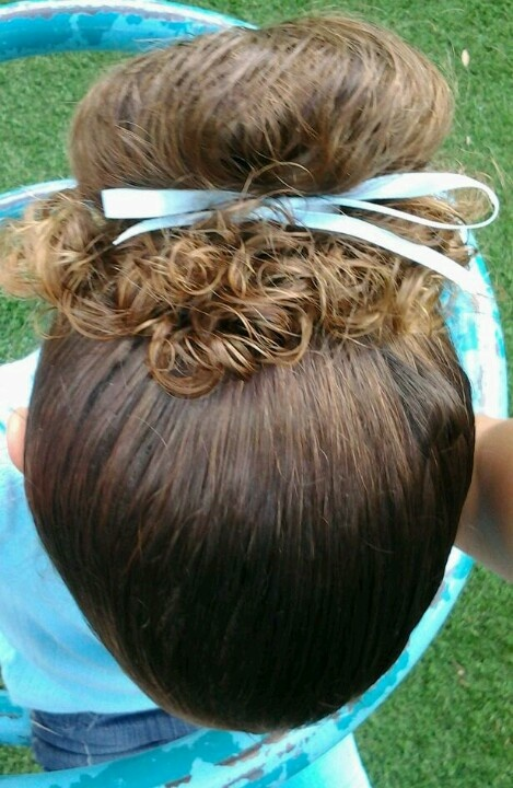 """Curly hair """"Up Do"""". Haha when i put my hair in a bun, it makes ringlets on the edges like that."""