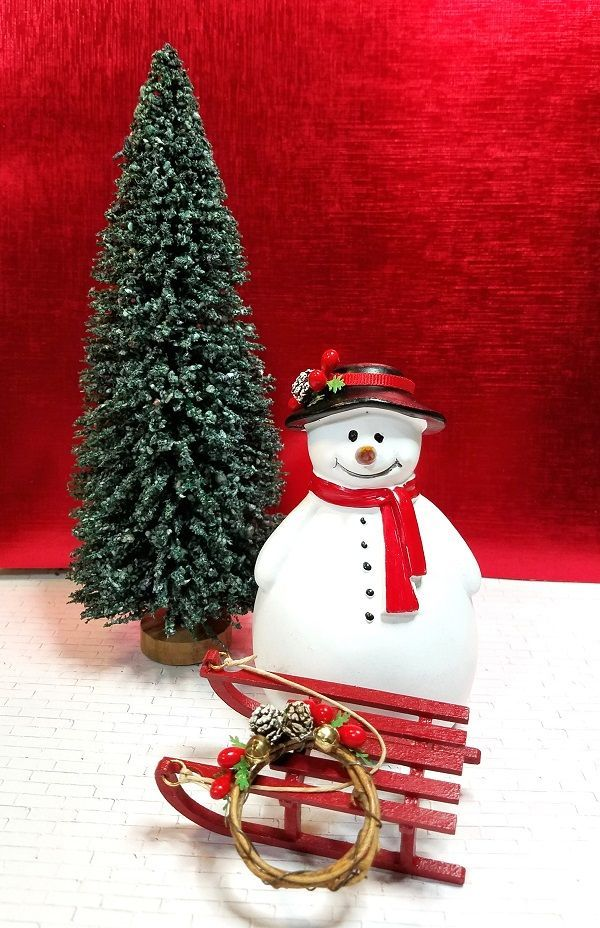 Roly Poly Snowman Getting Ready To Deliver A Holiday Wreath On His New Red Sledge The Tall Pi Mini Christmas Tree Christmas Fairy Garden Christmas Accessories