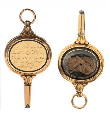 """Thomas Jeffersons Watch Key with a lock of his wife's hair and is inscribed """"Martha W. Jefferson"""""""