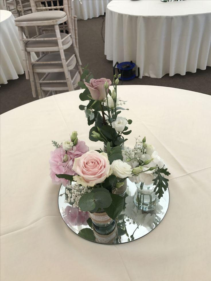 Jam Jar Arrangement: Gypsophila, Lisianthus, Silver Crest, Eucalyptus, Sweet Avalanche, Pink Hydrangea, Amnesia Rose, White Hydrangea on a mirrored plate