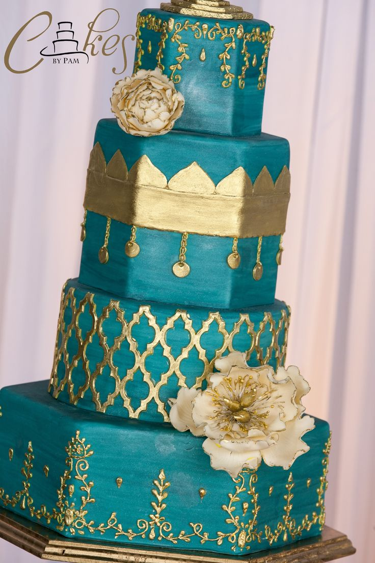 Moroccan inspired wedding cake with intricate scrollwork, Moroccan lattice and sugar peonies.