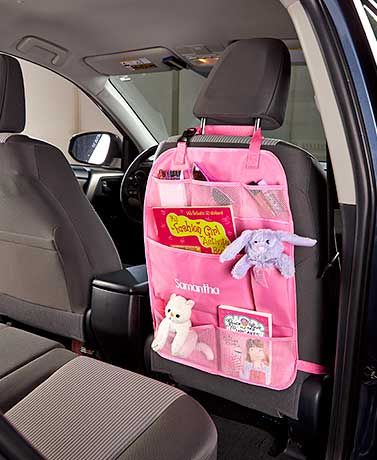 Minimize mess in your vehicle with this convenient Personalized Car Organizer. It's specifically designed to be hung around a headrest or strapped around one of the car's seats. Great organization tool for roadtrips