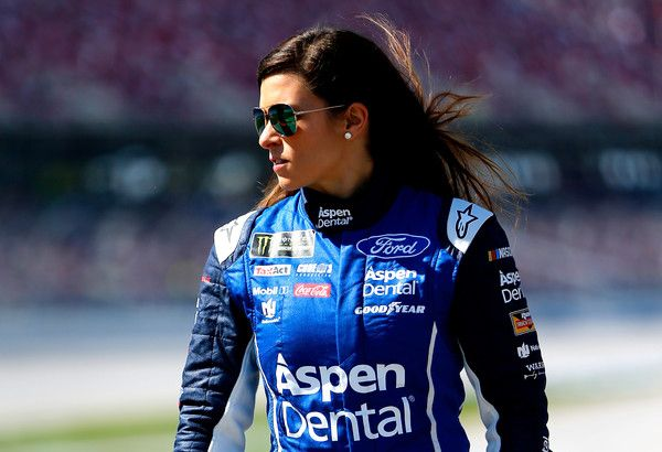 Danica Patrick Photos Photos - Danica Patrick, driver of the #10 Aspen Dental Ford, walks on the grid during qualifying for the Monster Energy NASCAR Cup Series GEICO 500 at Talladega Superspeedway on May 6, 2017 in Talladega, Alabama. - Talladega Superspeedway - Day 2