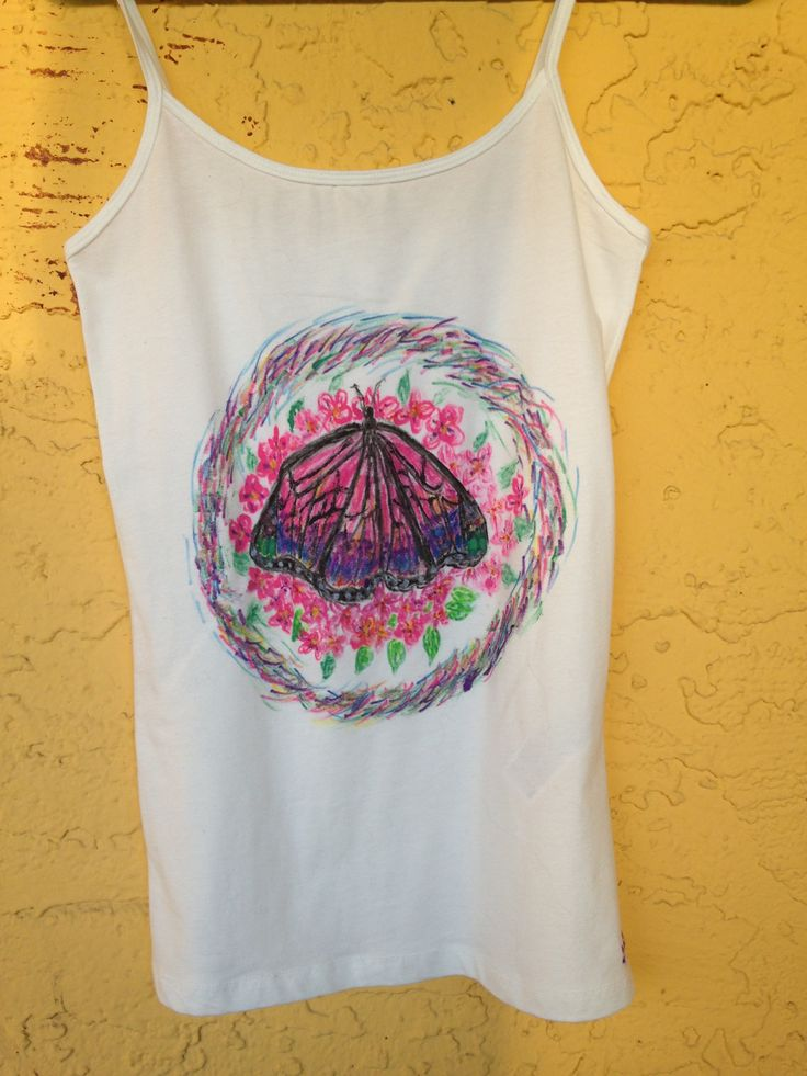 Ladies size medium white cami tank top features a beautiful colorful butterfly design. We design custom made clothing by hand using non toxic fabric markers, if you want your pets, nature or a specific design or scene drawn on a T-shirt, Tank Top or Sweatshirt please send us a message telling us what size and color of the clothing you need as well as a photo of the design you want drawn on your clothes. Custom designs that you do not see on our Etsy store that you want ordered take 2-3 days…