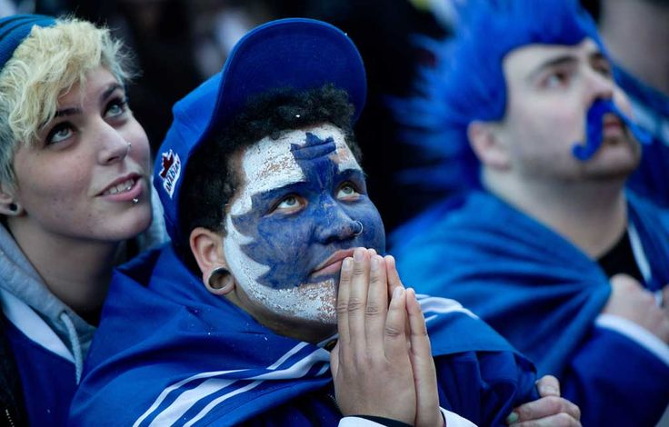 In the Maple Leafs, we trust. Hockey fans from Toronto, Canada.
