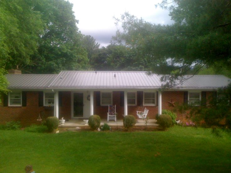 1000 images about metal roofing on pinterest exterior for Metal roof pictures brick house