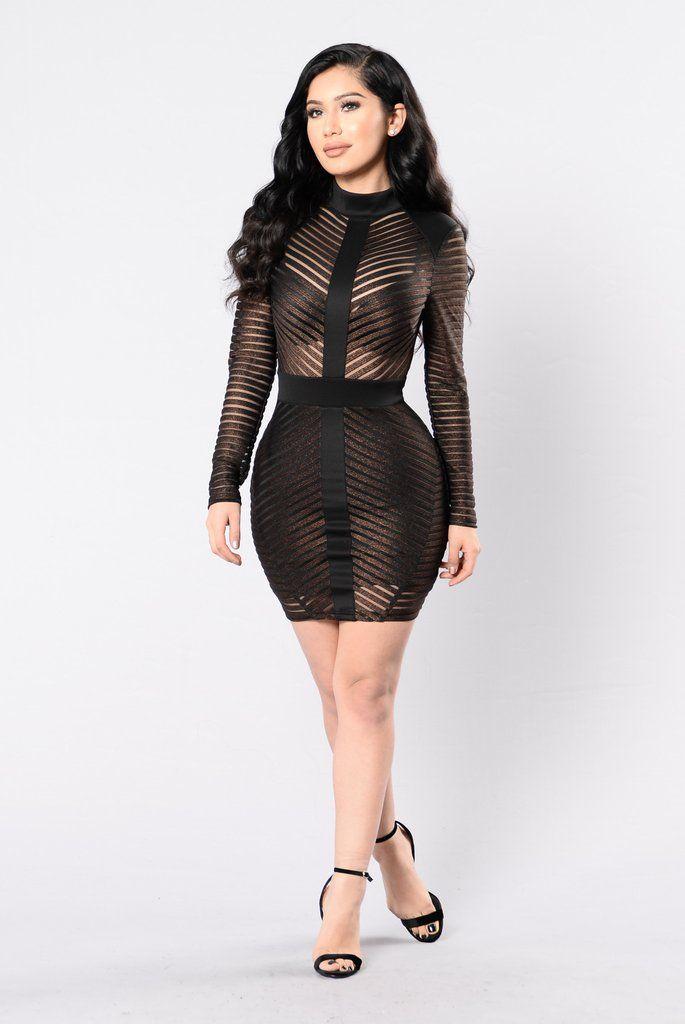 - Available in Bronze - Mesh Dress - Mock Neckline - Long Sleeve - Exposed Back Zipper - Lined Bottom - 95% Polyester 5% Spandex