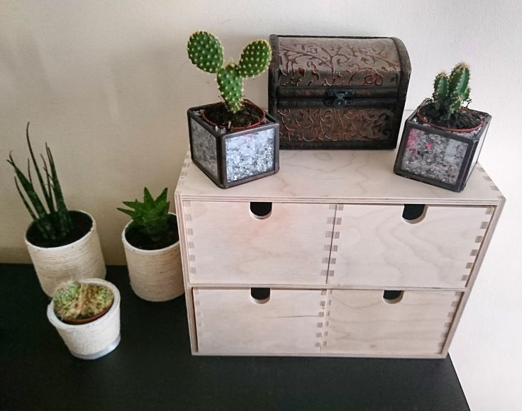 Small storage box from IKEA. Plant pots made out of Pringles (check other pins) and small candle holder from H&M (two small cactuses inside and shattered mirror/glass around the plant pots on the inside).