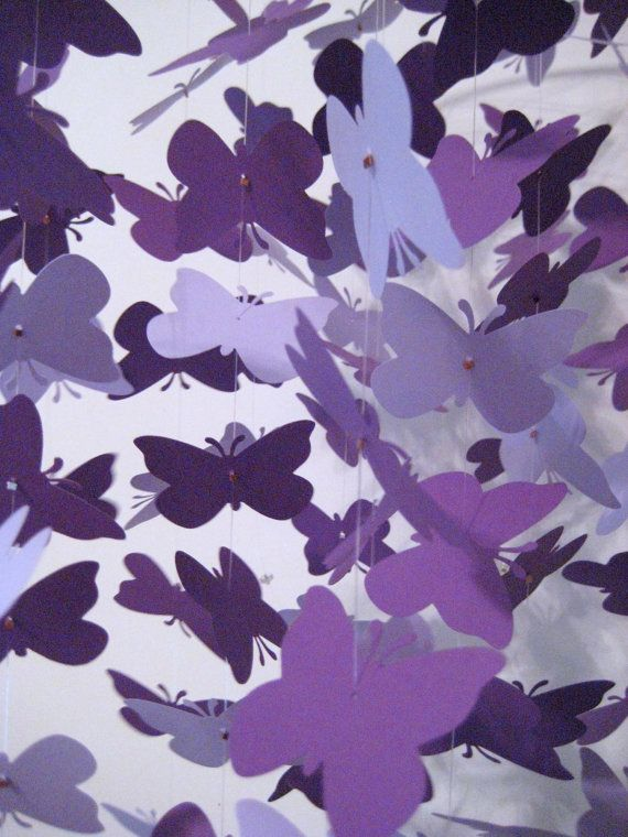 With brighter shades of purple, fuchia, and silver  Purple Butterfly Nursery Mobile. $55. Etsy.