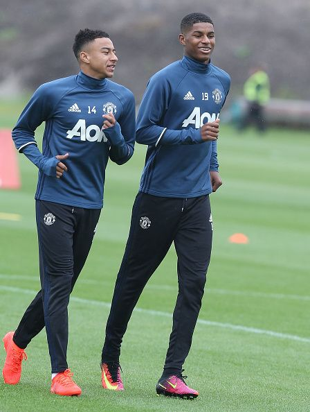 Jesse Lingard and Marcus Rashford of Manchester United in action during a first team training session at Aon Training Complex on July 28…