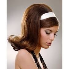 60s hair do for haloween.  I had this style with a headband or a ribbon.  Sprayed stiff with Just Wonderful hairspray.