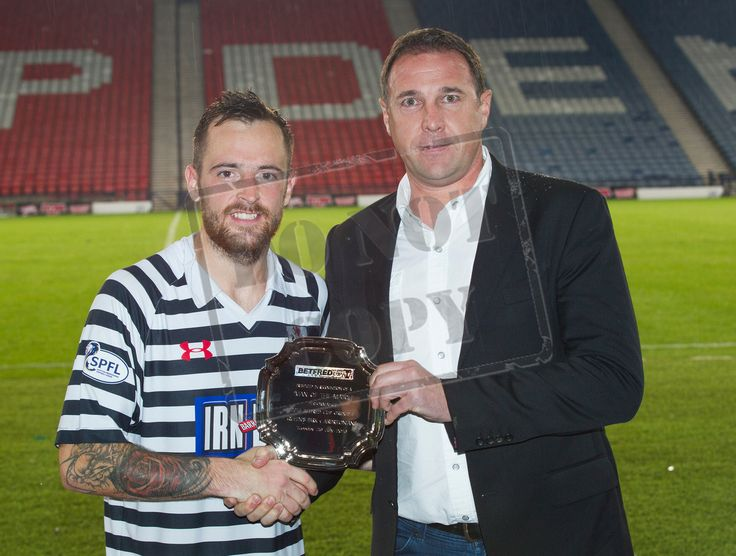 Queen's Park's Darren Miller receives his MOTM award from Malky Mackay after the Betfred Cup game between Queen's Park and Airdrieonians.
