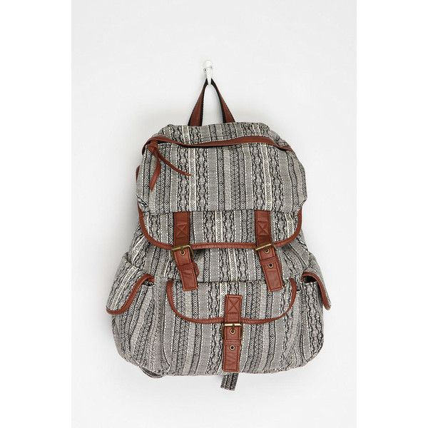 Sturdy canvas backpack from Ecote topped with an allover print. Distressed faux-leather trim. Antiqued hardware; magnetic snap and drawstring closures. Lined m…