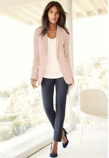 Pastel blazer with soft gray slacks.