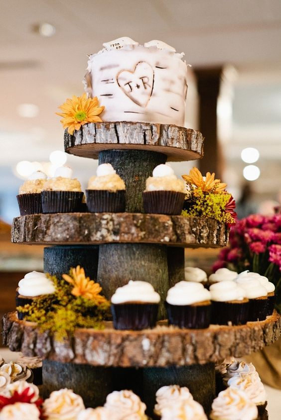 Tree bark cupcake tower with rustic wedding cake tier on top / http://www.deerpearlflowers.com/rustic-wedding-cupcakes-stands/