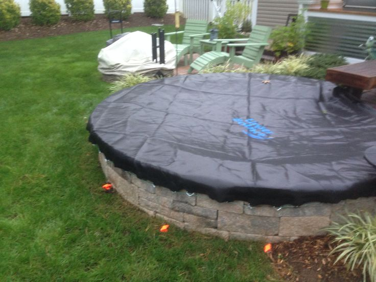 Stock tank mini pool cover...... Used a trampoline mat has the hooks built in a lot stronger than a tarp