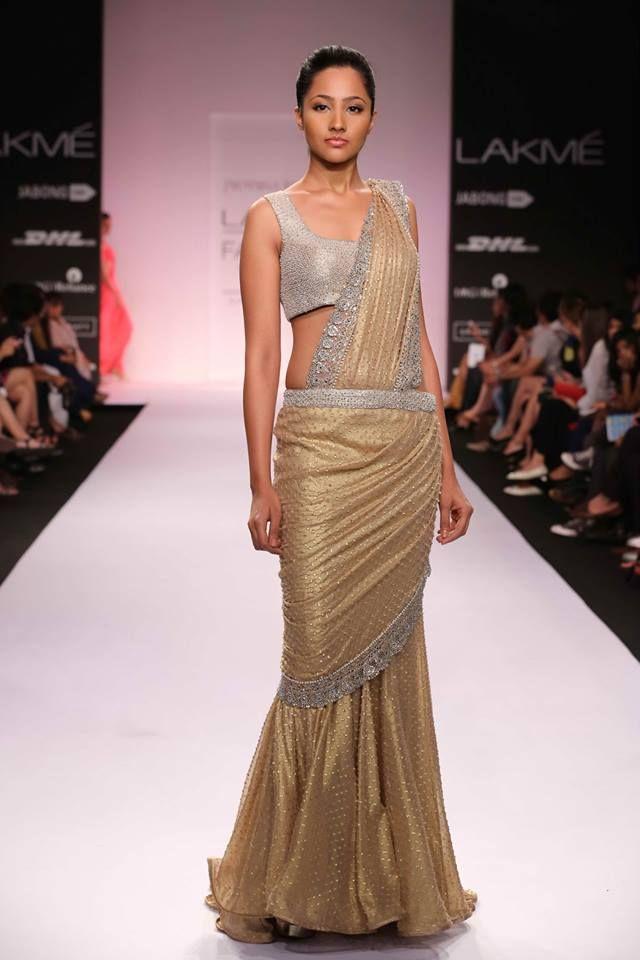 Jyotsna Tiwari Lakme Fashion Week Summer 2014 gold and silver fusion Indian wedding sari. More here: http://www.indianweddingsite.com/jyotsna-tiwari-lakme-fashion-week-summer-resort-2014/