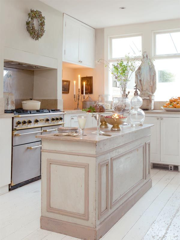 A nice narrow island perfect except a wider countertop to accommodate a couple stools so friends can visit while I cook!