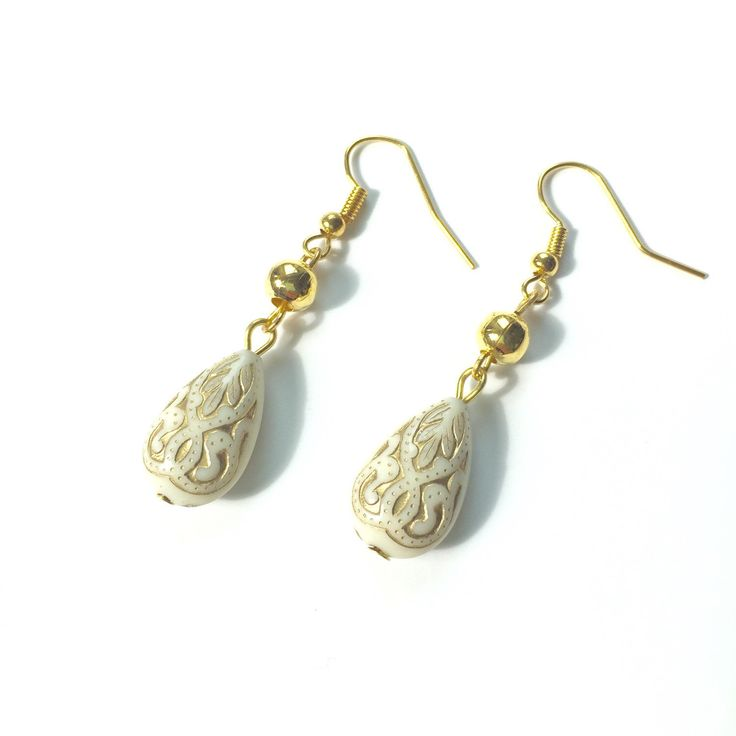 A personal favorite from my Etsy shop https://www.etsy.com/listing/244024665/filigree-cream-earrings-beautiful-cream
