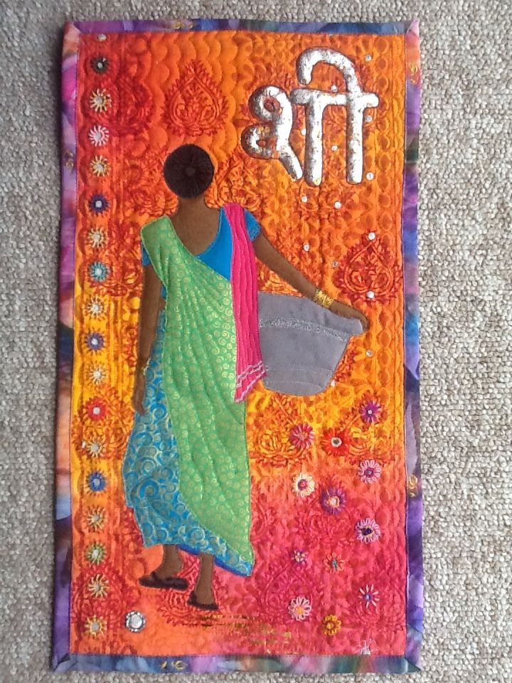 started in a Gillian Travis workshop in 2014.  Foil writing says 'she' in Hindi (I hope!) appliqued , hand and machine embroidered, stamped and quilted.