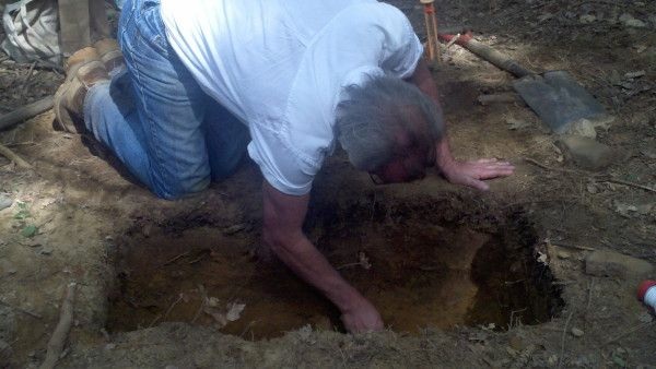 Dr. Kevin McBride using a trowel to scrape away a unit wall to see a clearer soil stratigraphy #archaeology #FS