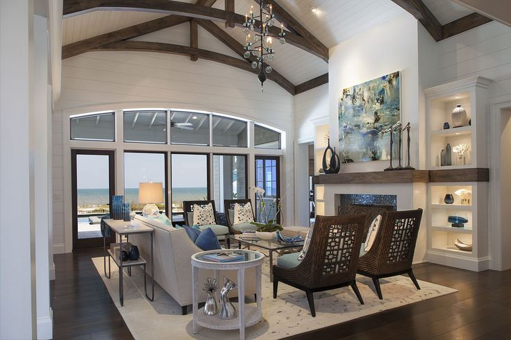 Amanda Webster Design: Transitional Coastal Color Interior Design / Photo: Neil Rashba / Living Room, stained ceiling beams, vaulted ceiling, arched beams, lit shelving, wrapped mantle, fireplace, mosaic tile surround, penny joint plank walls, v-joint ceiling