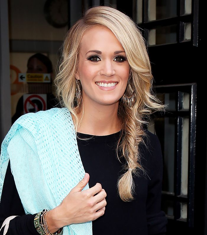 Carrie Underwood pulls off a side fishtail braid with loose curled front pieces for a perfect casual glam look