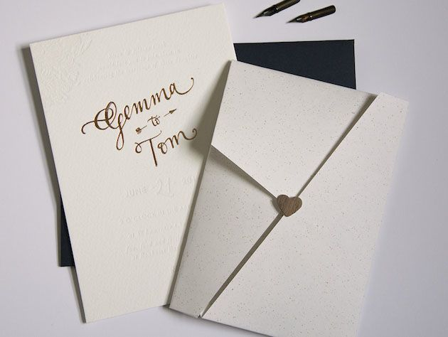 copper foil letterpress wedding invites plus origami fold maps with wooden heart sticker by Gemma Milly