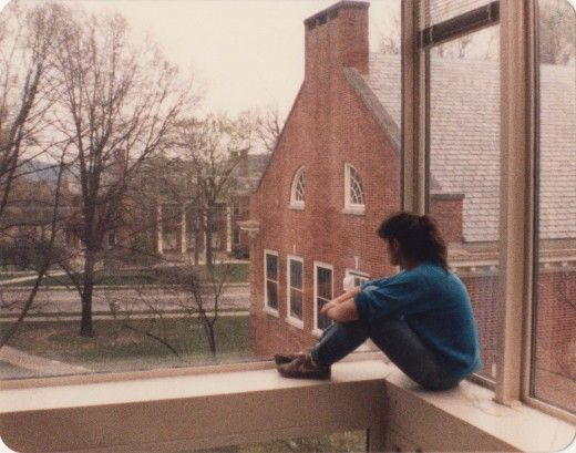 Student enjoying the view looking south from the airy Traylor Art Building, past the Rogers Art Building towards the Presser Music Building. berea college ky