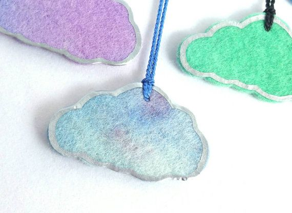 Check out this item in my Etsy shop https://www.etsy.com/au/listing/251971035/cloud-with-a-silver-lining-necklace-in