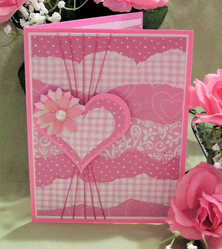 handmade Valentine card ... monochromatic pinks ... luv the use of coordinating patterned papers ... layered heart ... like the string positioning ... delightful!